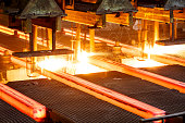 hot steel on conveyor Close shot in steel mill