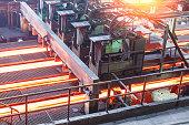 hot steel on conveyor in steel plant,industrial background