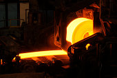Hot orange steel rolling process in a steel manufacturing industry. Hot rolling is a metalworking process used mainly to produce sheet metal or simple cross sections, such as rail tracks. Other typica