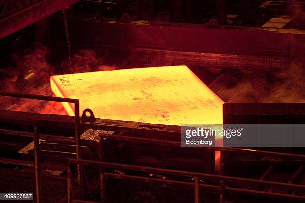 A hot steel slab exits the reheating furnace before moving to the plate mill on the production line at the Ruukki Metals Oy steel mill in Oulu...