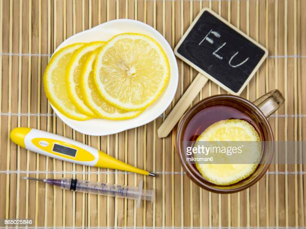 Hot tea, Capsules and pills and Digital medical thermometer. Medical concept