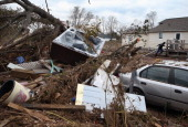 A hot tub lies in a pile of debris on November 1 2012 in the Ocean Breeze area of the Staten Island borough of New York City Most homes in the...