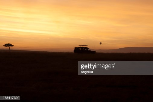 Hot-air Balloon and Safari car at Sunrise, Masai Mara, Kenya