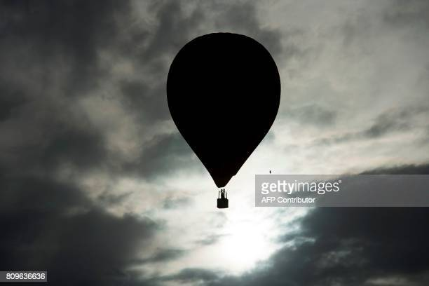 TOPSHOT A hotair balloon flies during the 21th European Balloon Festival in Igualada near Barcelona on July 6 2017 The European Balloon Festival is...