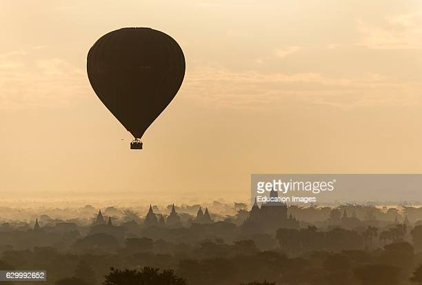 Hotair Balloon in flight over temples of Bagan Burma Myanmar