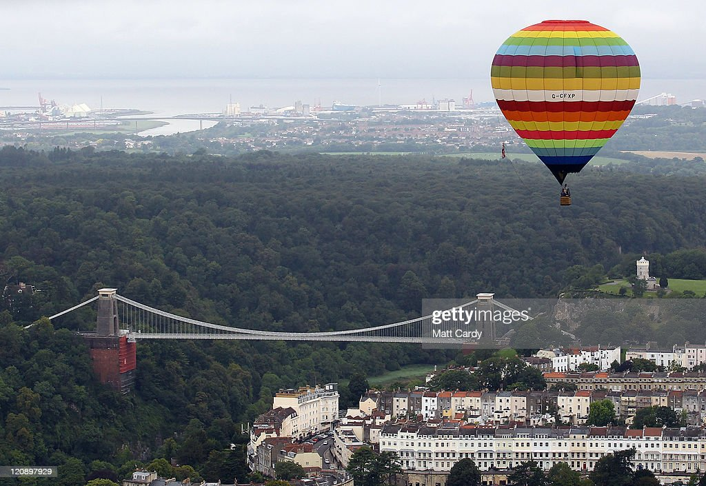 Hotair balloons begin to rise during the early morning mass assent which saw over 60 balloons launched at the Bristol International Balloon Fiesta at...