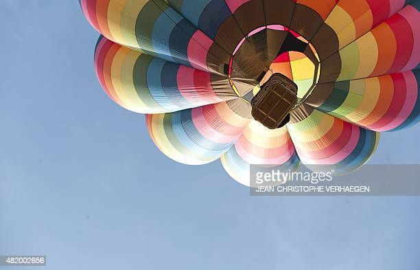 A hotair balloons flies over ChambleyBussieres eastern France on July 26 on the first day of the international airballoon meeting 'Lorraine Mondial...