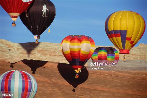 Hot-air balloons floating over desert