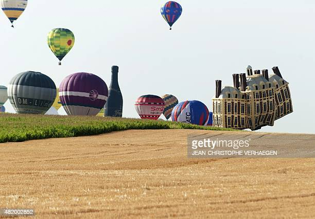 Hotair balloons fly near ChambleyBussieres eastern France on July 26 on the first day of the international airballoon meeting 'Lorraine Mondial Air...