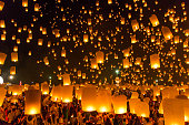 Sky lanterns with fireworks, flying lanterns, floating lanterns, hot-air balloons , Loy Krathong (Yi Peng) Festival in Chiang Mai Thailand