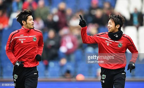 Hotaru Yamaguchi and Hiroshi Kiyotake of Hannover during warm up prior to the Bundesliga match between Hannover 96 and 1 FC Koeln at HDIArena on...