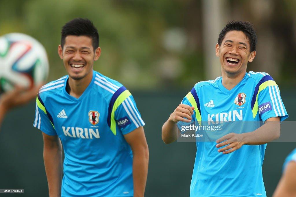 Hotaru Yamaguchi and Shinji Kagawa laugh during a Japan training session at North Greenwood Recreation & Aquatic Complex on June 1, 2014 in Clearwater, Florida.
