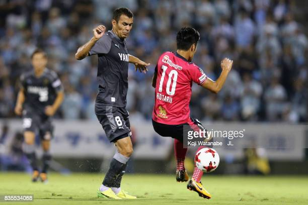 Hotaru Yamaguchi of Cerezo Osaka and Fozil Musaev of Jubilo Iwata compete for the ball during the JLeague J1 match between Jubilo Iwata and Cerezo...