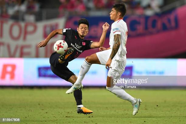 Hotaru Yamaguchi of Cerezo Osaka and Joaquin Correa of Sevilla FC compete for the ball during the preseason friendly match between Cerezo Osaka and...