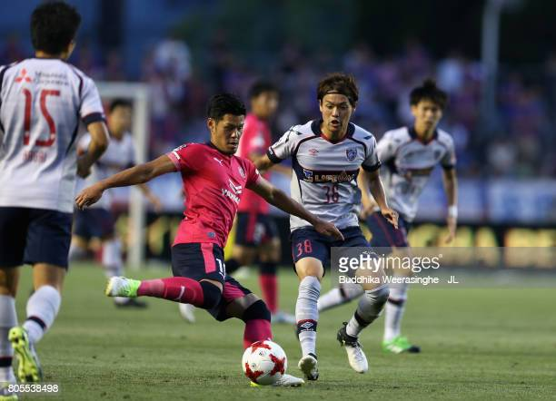Hotaru Yamaguchi of Cerezo Osaka and Keigo Higashi of FC Tokyo compete for the ball during the JLeague J1 match between Cerezo Osaka and FC Tokyo at...