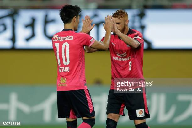 Hotaru Yamaguchi of Cerezo Osaka celebrates scoring his side's fourth goal with his team mate Souza during the JLeague J1 match between Vegalta...
