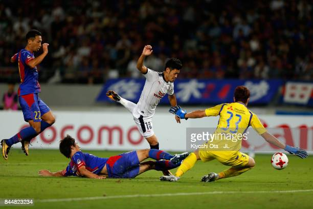 Hotaru Yamaguchi of Cerezo Osaka is tackled by FC Tokyo player during the JLeague J1 match between FC Tokyo and Cerezo Osaka at Ajinomoto Stadium on...