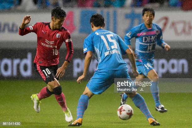 Hotaru Yamaguchi of Cerezo Osaka takes on Jung Seung Hyun of Sagan Tosu during the JLeague J1 match between Sagan Tosu and Cerezo Osaka at Best...