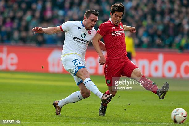 Hotaru Yamaguchi of Hannover and Christian Clemens of Mainz compete for the ball during the first Bundesliga match between Hannover 96 and 1 FSV...