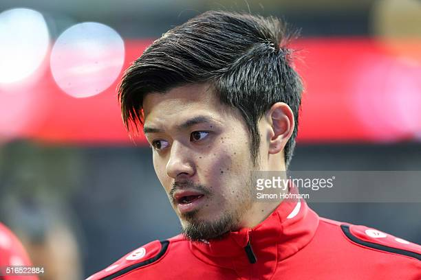 Hotaru Yamaguchi of Hannover looks on as he warms up prior to the Bundesliga match between Eintracht Frankfurt and Hannover 96 at CommerzbankArena on...