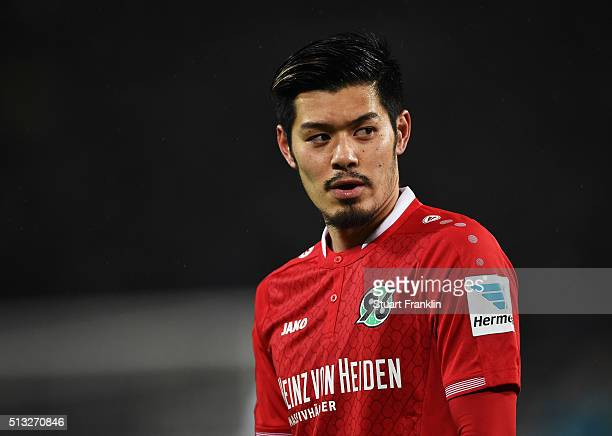 Hotaru Yamaguchi of Hannover looks on during the Bundesliga match between Hannover 96 and VfL Wolfsburg at HDIArena on March 1 2016 in Hanover Germany