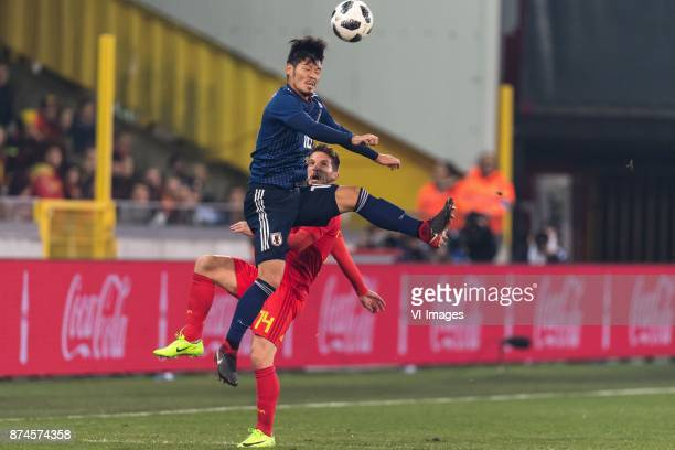 Hotaru Yamaguchi of Japan Dries Mertens of Belgium during the friendly match between Belgium and Japan on November 14 2017 at the Jan Breydel stadium...
