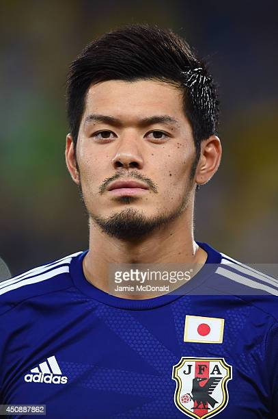 Hotaru Yamaguchi of Japan looks on during the National Anthem prior to the 2014 FIFA World Cup Brazil Group C match between Japan and Greece at...