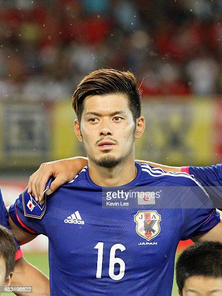 Hotaru Yamaguchi of Japan stands on the field before the match against China during the EAFF East Asian Cup 2015 final round at the Wuhan Sports...