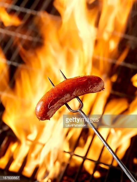 Hotdog (Smokie) Cooking on the Campfire