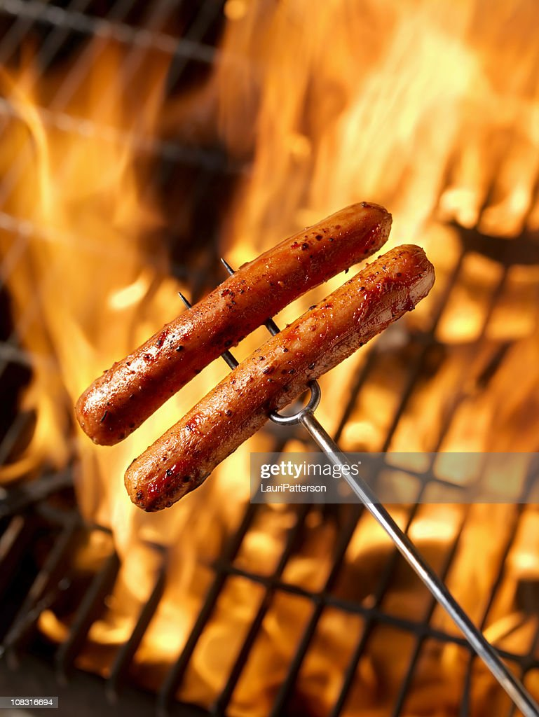 Hotdogs Cooking on the Campfire : Stock Photo