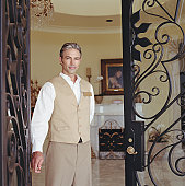 Hotel attendant standing in doorway, portrait