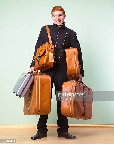 Hotel bellboy bellhop with customer luggage