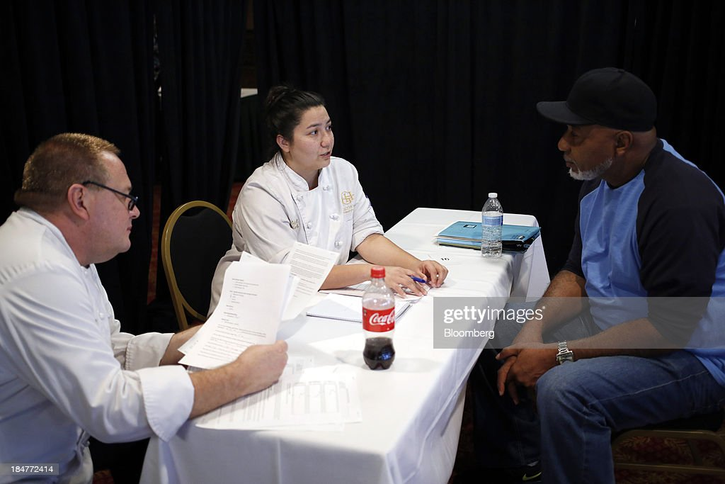 Hotel chefs conduct an interview with job seekers during a job fair hosted by the Galt House Hotel in Louisville, Kentucky, U.S., on Monday, Oct. 14, 2013. Improvement in the U.S. labor market may soon speed up, building on gains during the past year, Federal Reserve researchers said, citing six employment indicators. Photographer: Luke Sharrett/Bloomberg via Getty Images