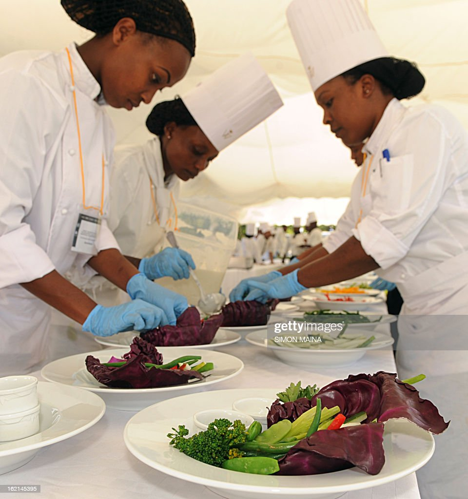 Hotel chefs prepare to serve rejected green salad, grown by Kenyan farmers but rejected by UK supermarkets due to cosmetic imperfections, on February 19, 2013 during the Governing Council of the United Nations Environment Programme (UNEP) at the UN headquarters in Nairobi. The campaign aims to promote actions by consumers and food retailers to dramatically cut the 1.3 billion tonnes of food lost or wasted each year -- which, aside from the cost implications and environmental impacts, increases pressure on the already straining global food system -- and help shape a sustainable future. AFP PHOTO / SIMON MAINA