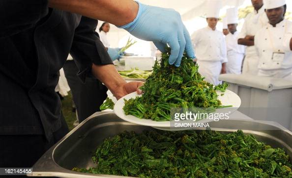 Hotel chefs prepare to serve rejected green salad grown by Kenyan farmers but rejected by UK supermarkets due to cosmetic imperfections on February...