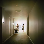 Hotel cleaning staff in hallway