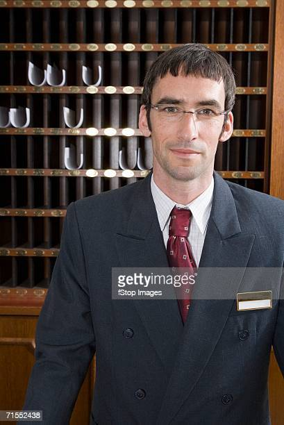 Hotel clerk at hotel reception
