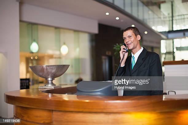 Hotel concierge talking on phone