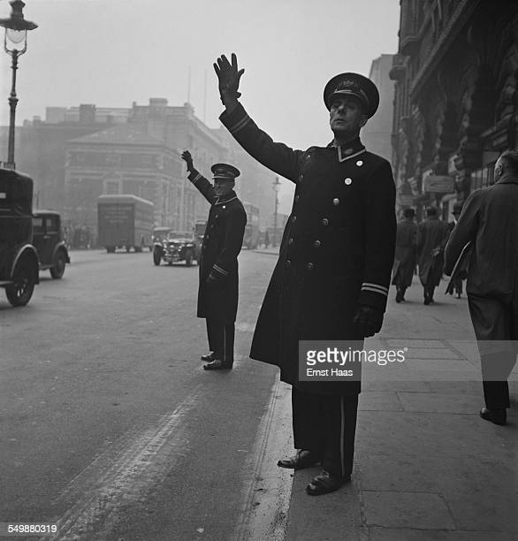 Hotel door attendants stand on the street to hail taxi's for guests Piccadilly London circa 1953