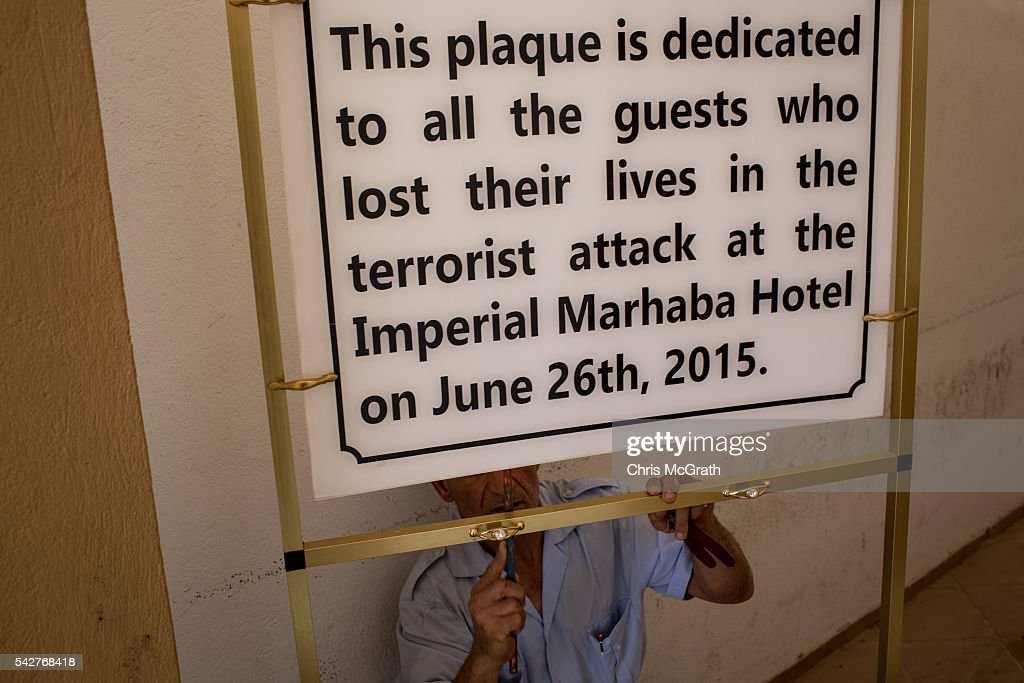 A hotel employee fixes a memoriam sign in preparation for the anniversary of the Sousse Beach attack at the closed Imperial Marhaba Hotel on June 24, 2016 in Sousse, Tunisia. The Imperial Marhaba hotel was the main target of the 2015 Sousse beach terrorist attack that killed 38 people including 30 Britons. The hotel attempted to stay open for three months after the attacks, however low occupancy forced the hotel to close. Since then it has operated with a skeleton staff, who work to maintain the rooms and grounds, other permanent hotel staff were able to be placed in temporary jobs at two other hotels owned by the same chain. The hotel hopes to open again by next spring or as soon as British travel advisories and restrictions are lifted for Tunisia. Before the 2011 revolution, tourism in Tunisia accounted for approximately 7% of the countries GDP. The two 2015 terrorist attacks at the Bardo Museum and Sousse Beach saw tourism numbers plummet even further forcing hotels to close and many tourism and hospitality workers to lose their jobs. The 26th of June 2016 marks the anniversary of the Sousse beach attacks.