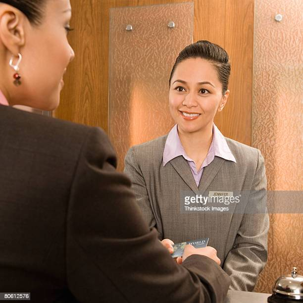 Hotel employee taking guest's credit card