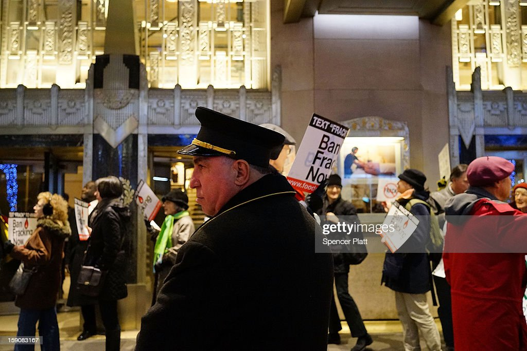 A hotel employee watches as anti Fracking protesters demonstrate in front of the Waldorf Astoria as New York Gov. Andrew Cuomo visits the hotel for a function on January 7, 2013 in New York City. Fracking, a process that injects millions of gallons of chemical mixed water into a well in order to release gas, has become a contentious issue in New York as critics of the process believe it contaminates drinking water among other hazards. New York City gets much of its drinking water from upstate reservoirs. If the regulations are approved by Governor Cuomo, drilling in the upstate New York Marcellus Shale could later this year.