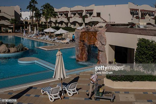 A hotel employee works around the pool at a resort on April 2 2016 in Sharm El Sheikh Egypt Prior to the Arab Spring in 2011 some 15million tourists...