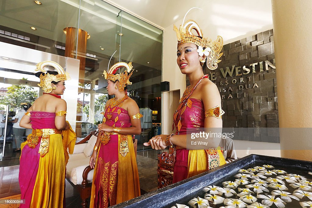 Hotel employees in traditional Balanese dress wait to greet guests at the Hotel hosting the Miss World 2013 competition on September 8, 2013 in Nusa Dua, Indonesia. Indonesia's government has moved the final round of the Miss World pageant from main Java island to the resort island of Bali due to the ongoing Muslim protests.