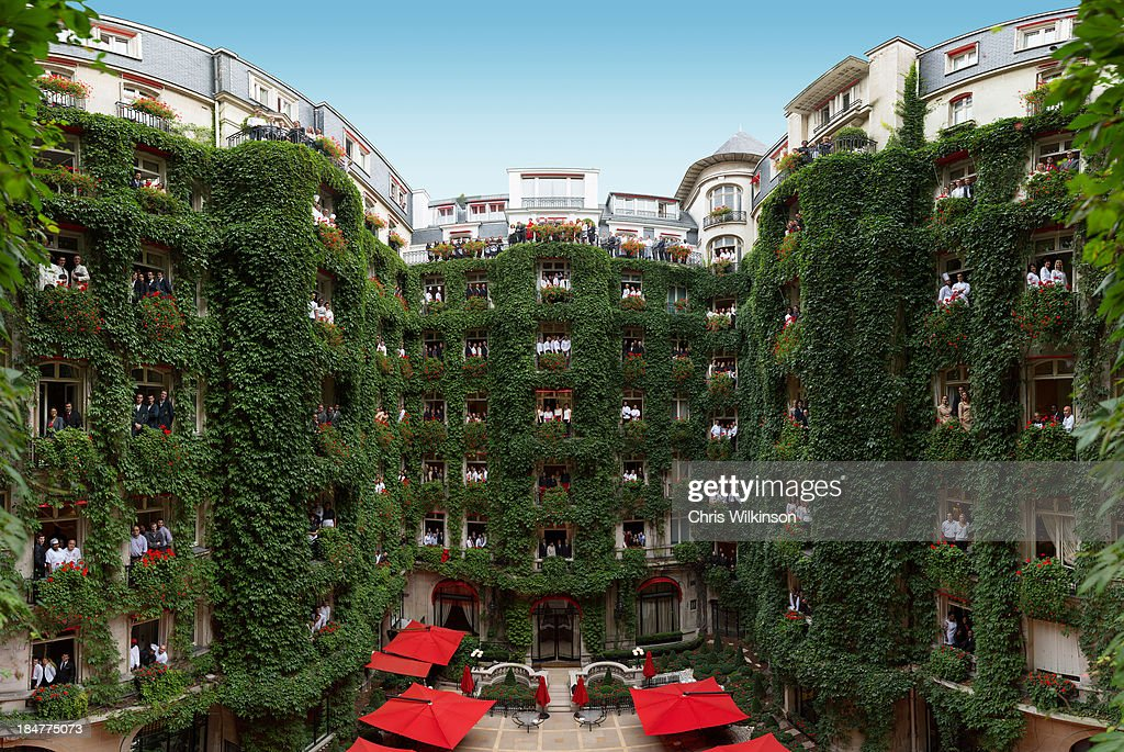 297 hotel employees pose at open windows of the Plaza Athenee on October 1 2013 in Paris France The historic 100 year old Parisien hotel is closing...