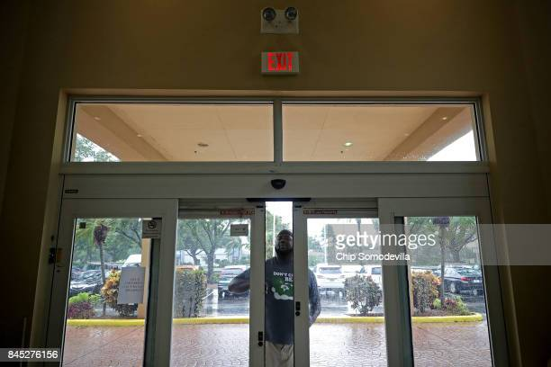 A hotel guest opens the automatic doors by hand after the Courtyard by Marriott was left without power by Hurricane Irma September 10 2017 in Fort...