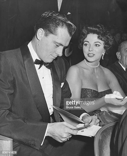 Hotel heir Nicky Hilton and actress Joan Collins together at a the premiere of the film 'Heaven Knows Mr Allison' 1957