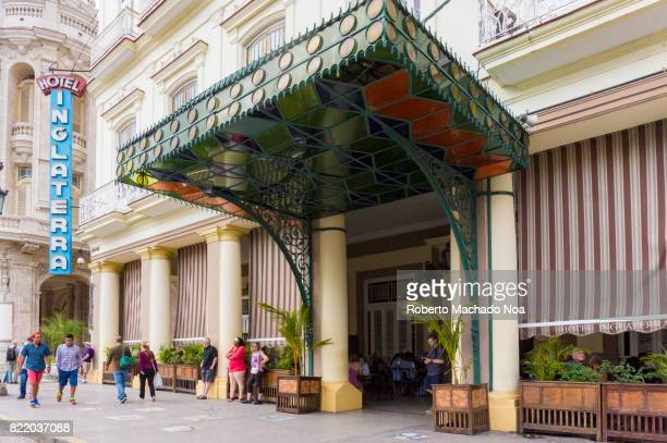 'Hotel Inglaterra' entrance The landmark is located in 'Central Park' People hanging around the white building with a colourful glass canopy at the...