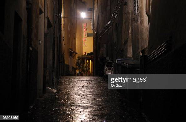 A hotel is seen up a dark alley in the medieval walled hilltown of Perugia as night falls on December 4 2009 in Perugia Italy The town is the capital...