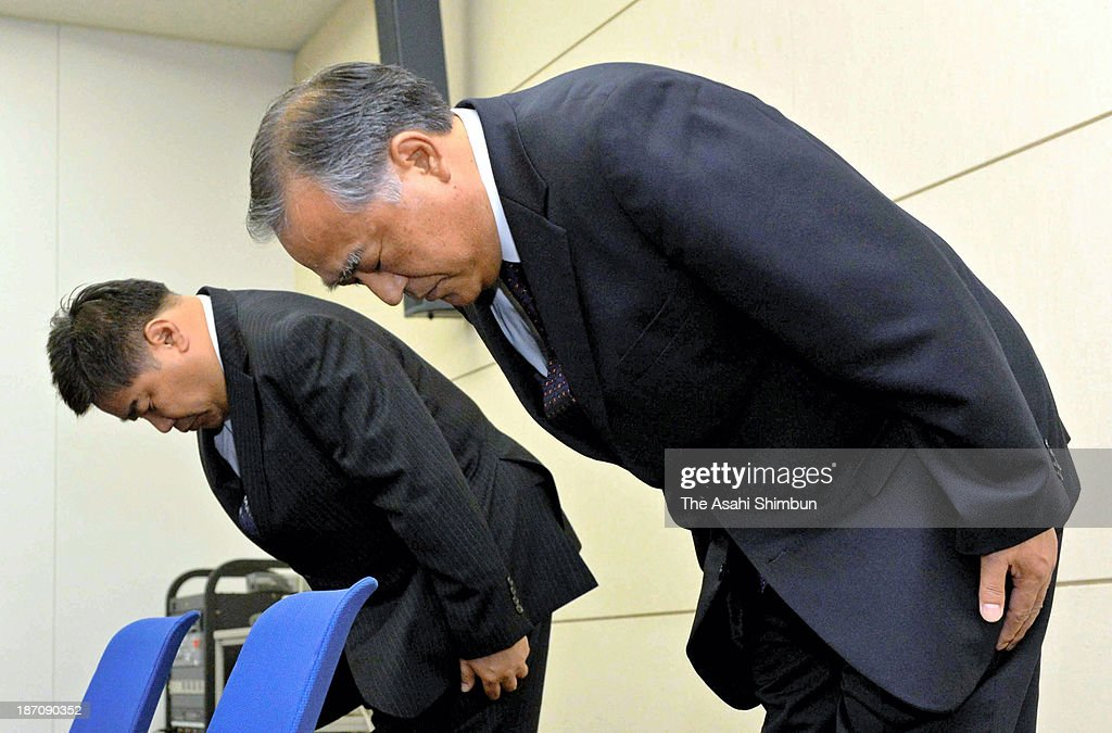 Hotel Keihan President Toshiya Kudo (R) bows for apology during a press conference on November 5, 2013 in Osaka, Japan. The hotel chain had offered processed meat sprayed with beef cattle tallow as beef 'steak' at its three restaurants. The latest menu mislabeling scandal surfaced late last month, when Hankyu Hanshin Hotels Co. announced that 47 food items served at its hotels, became a nationwide growing scandal that has sparked consumer outrage and prompted government calls for industry-wide investigations. Japan has no legislation stipulating clear standards for menu displays at restaurants, meaning that the companies did not necessarily violate the law.